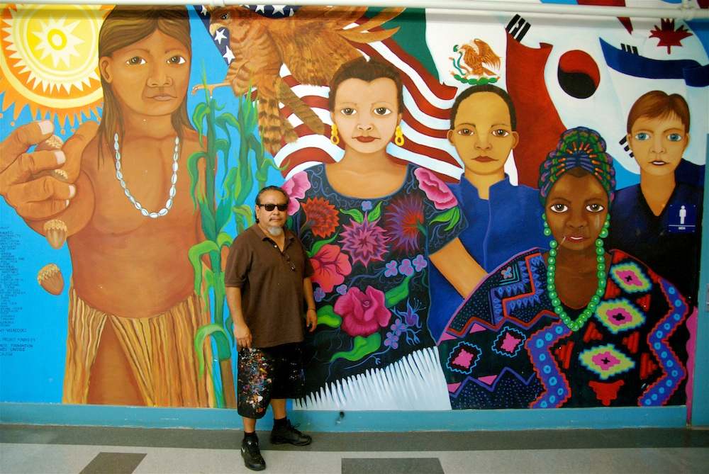 Manny Velazquez celebrates the 20th anniversary of this mural in Fulton Middle School!